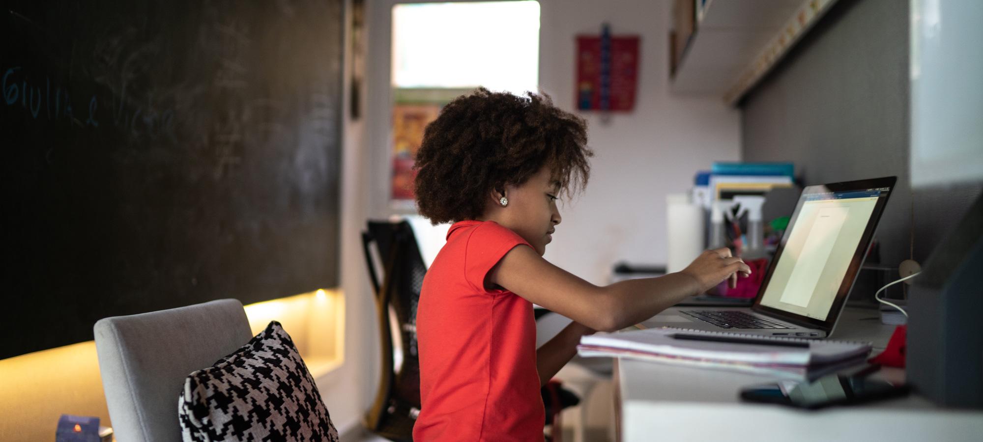 photo - Elementary Girl Studying on Laptop