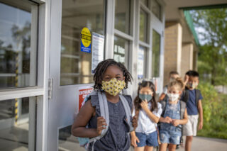 photo - Elementary School Students Wearing Masks and Returning to School