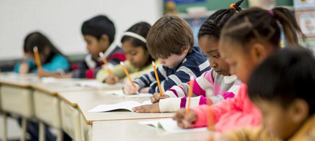 photo - Elementary Students at Desks Taking Test
