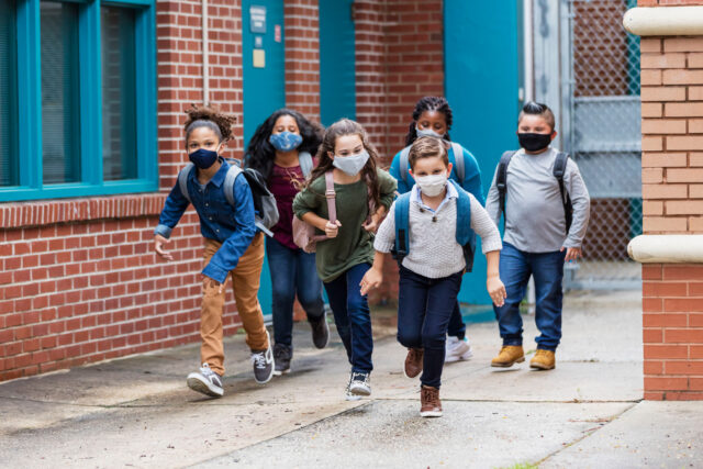 photo - Elementary Students Leaving School and Wearing Masks