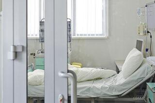 photo - Empty ICU Bed Behind Glass Door