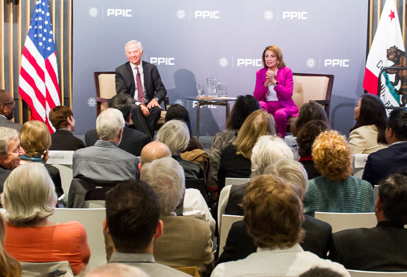Photo of Mark Baldassare and Nancy Pelosi with audience