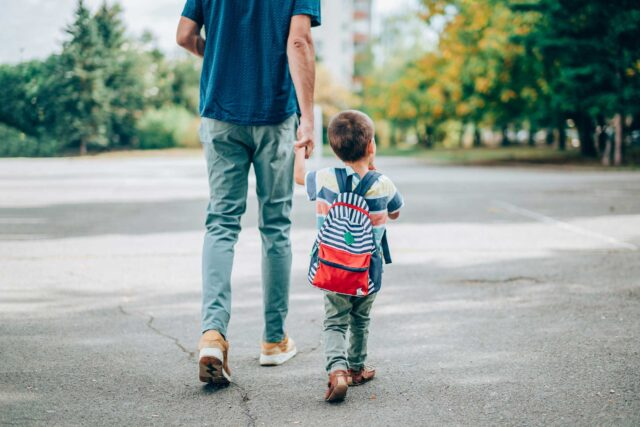 photo - Father and Son Holding Hands Walking