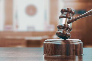 photo - Gavel in Blurry Courtroom