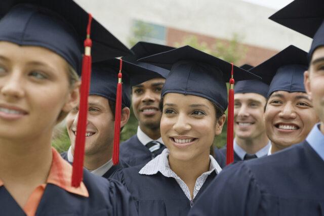 photo - Graduates Smiling at Graduation