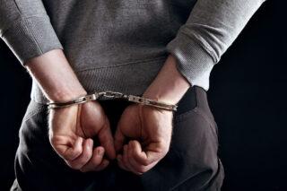 photo - Hands Locked in Handcuffs