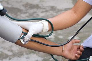 photo - Health Professional Checking Blood Pressure