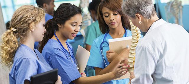 photo - Professor Using Model to Train Nursing Students