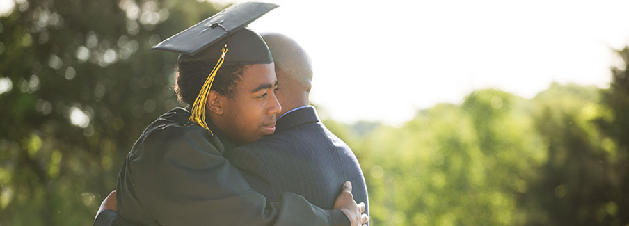 photo - Graduate Hugging His Father