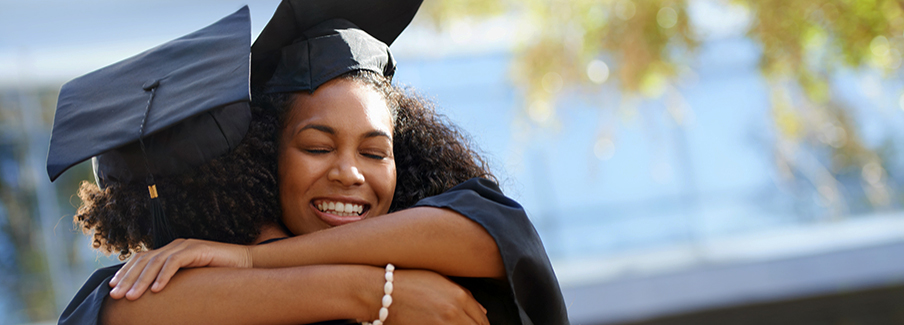 photo - college graduates hugging
