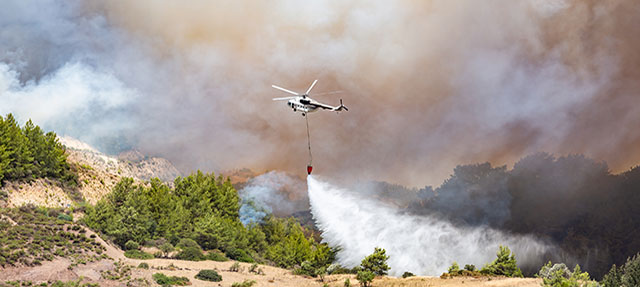 photo - Helicopter Dropping Water for Fire Fighting