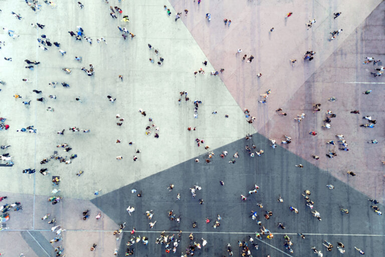 photo - High Angle View of People on the Street in Segments