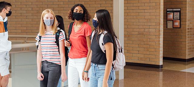 photo - High School Students Walking in Hallway, Wearing Masks