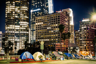 photo - Homeless Tents Beside Skyscrapers in Los Angeles Downtown at Night