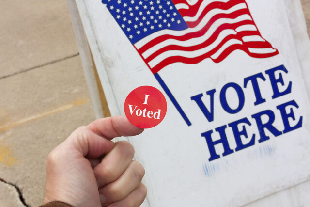 photo - I voted sticker and vote here sign