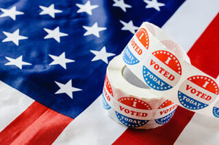 photo - I Voted Today Stickers and the US Flag