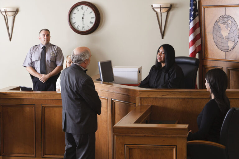 photo - Judge Listening to Lawyer in Courtroom