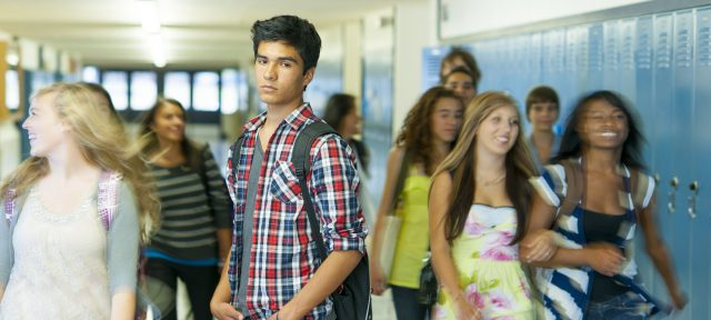latino high school student in hallway
