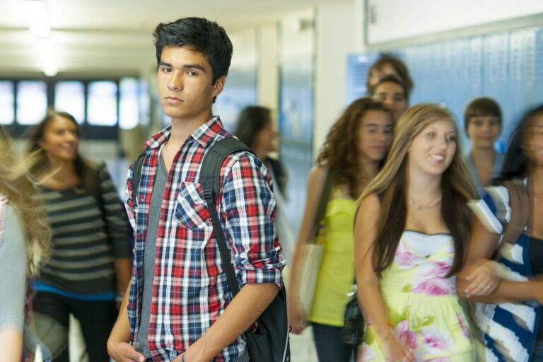 latino high school student in hallway