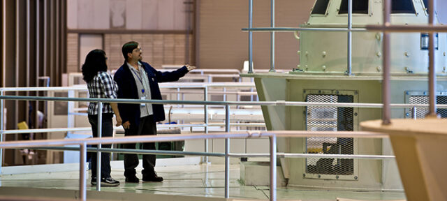 Surveying a generator unit at the California Department of Water Resources Devil Canyon Powerplant. The facility located in San Bernardino County generates electricity from water traveling through the plant from Silverwood Lake. The water is then discharged into two afterbays which water is distributed to contracting water users. Photo taken April 6, 2012.   John Chacon / California Department of Water Resources, FOR EDITORIAL USE ONLY