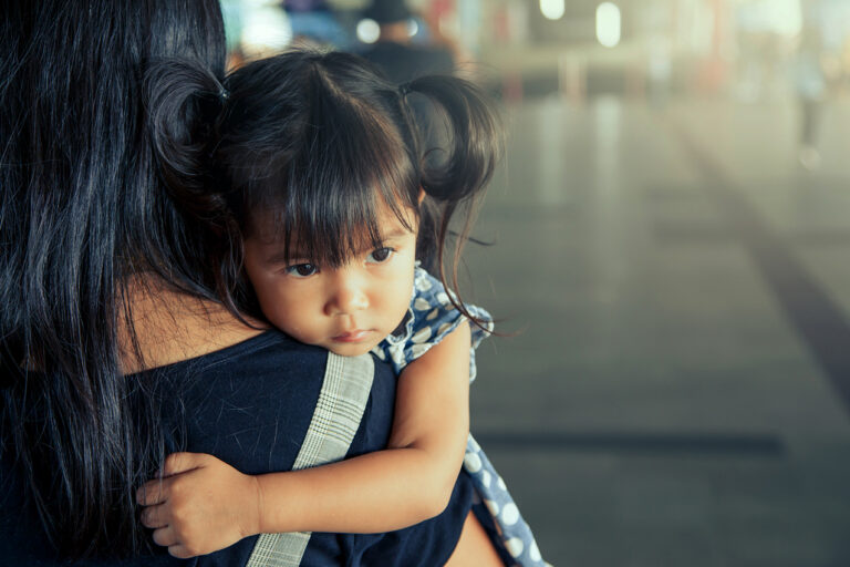 photo - Little Girl Held By Mother
