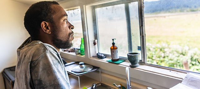 photo - Man at Kitchen Sink Looking Out Window