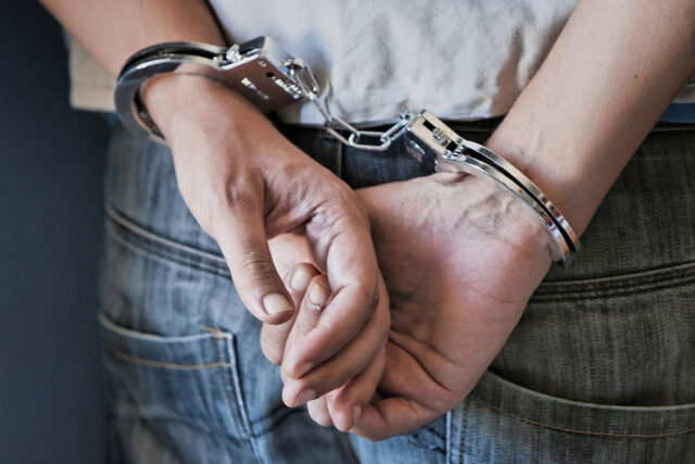 Photo of man in handcuffs