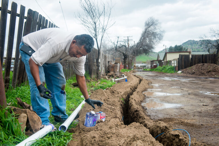 photo - Man Installing Water Pipeline to Home in East Porterville, California - pixel-ca-dwr-FL_Porterville-5307
