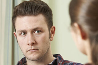 photo - Man Listening during Counseling with Woman