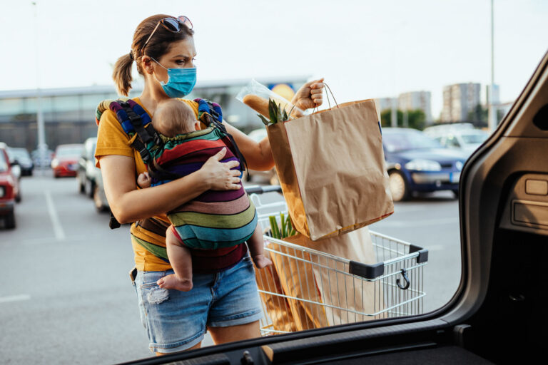 photo - Mother with Baby Putting Groceries in Car