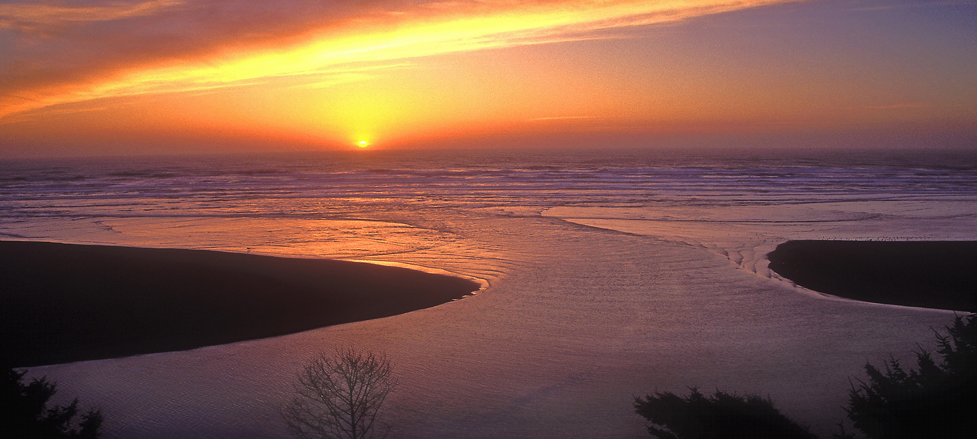 The mouth of mad river at sunset