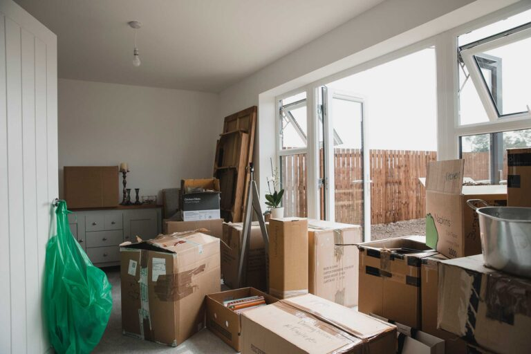 photo - Moving Boxes in Living Room of New Home