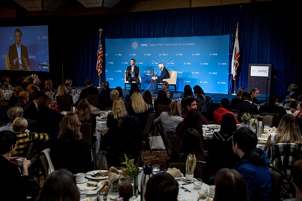 Photo of Governor Newsom and Mark Baldassare with the audience