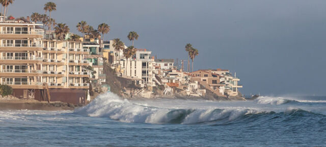 photo - Ocean Waves Hitting Housing on Southern California Coastal Housing