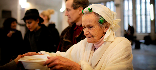 Photo: Older woman In soup kitchen line