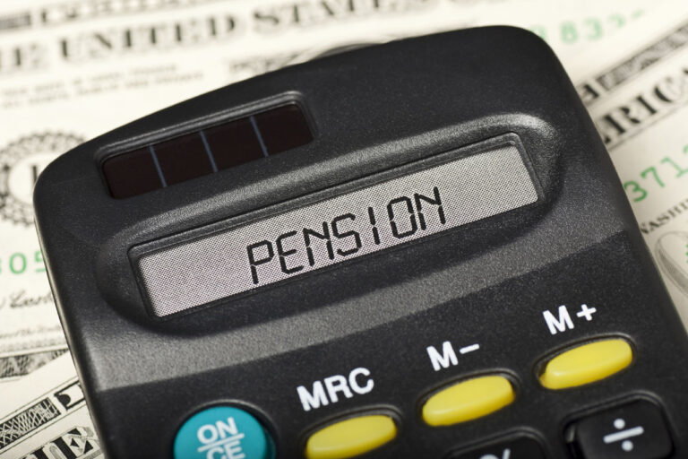 photo - Pension on Calculator Display and Money