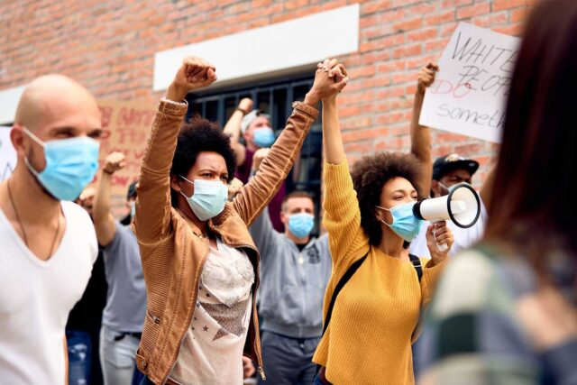 photo - People Wearing Protective Masks While Protesting at an Anti-Racism Demonstration