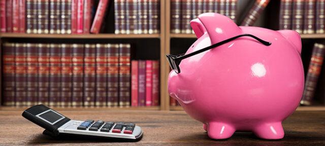photo - Pink Piggybank and Calculator