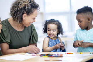 photo - Preschool Students and Teacher Coloring