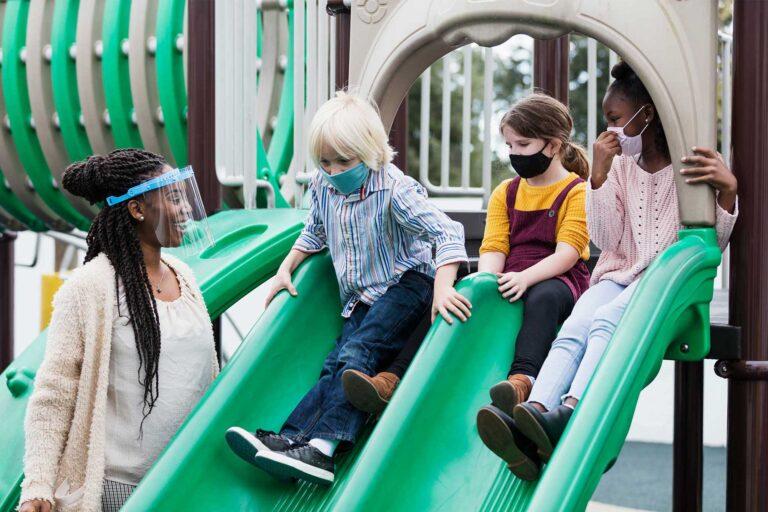 photo - Preschoolers on Slides, Next to Teacher