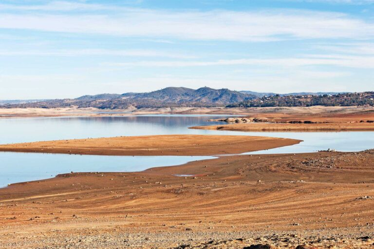 photo - Sandy Shoreline of Lake with Low Water Level