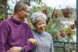 photo - Senior Couple Walking Together