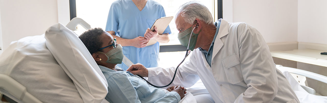 photo - Doctor Listening to Patient's Heart in Hospital