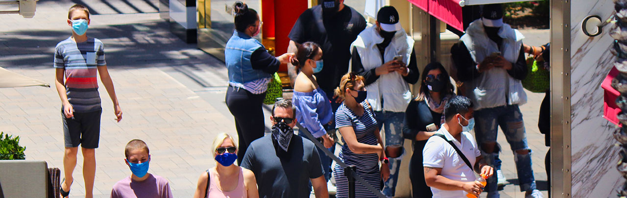 photo - Masked People on Street in San Diego, California