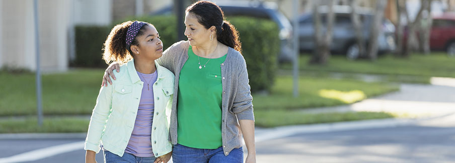 photo - Mother and Daughter Walking Together
