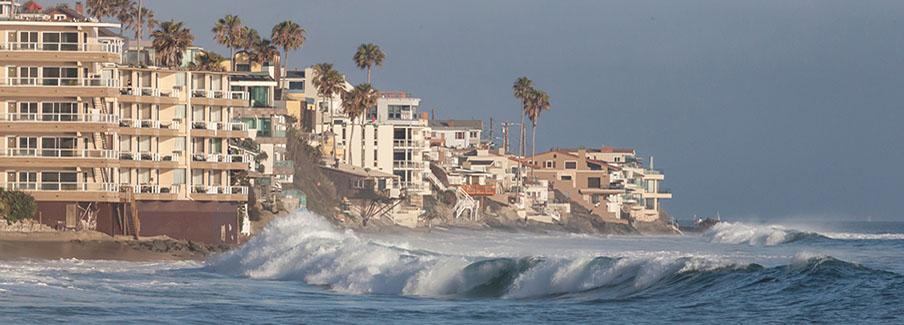 photo - Ocean Waves Hitting Housing on Coast