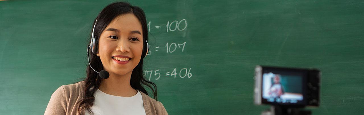 photo - Teacher Delivering Instruction Online