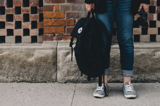 photo - Student Holding Backpack