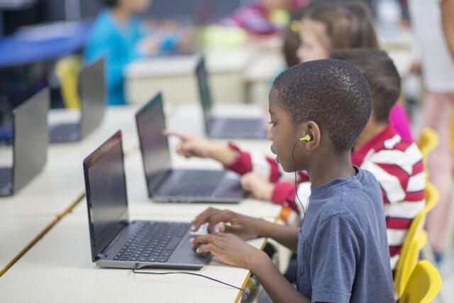 photo - Student on Laptop