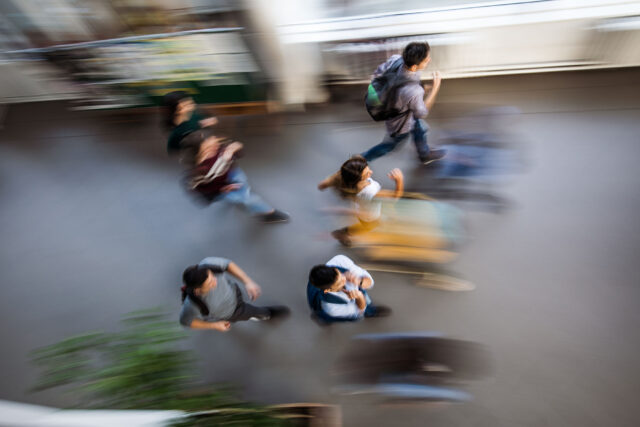 photo - Students in Hallway, Blurred, Overhead View
